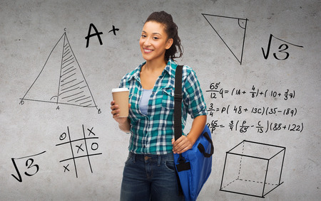 education, technology and people concept - smiling female african american student with bag and take away coffee cup photo
