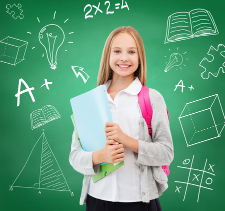 education and school concept - happy and smiling teenage girl photo
