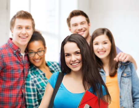 high school students: education, technology and people concept - smiling student with bag, folders and tablet pc computer standing Stock Photo