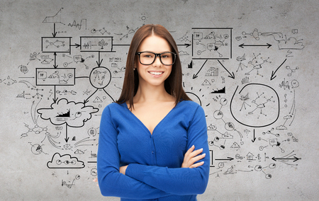 business and education concept - smiling businesswoman, teacher or student in glasses with big plan on the back photo