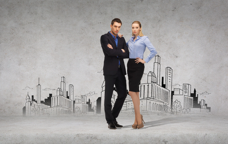 business, office and education concept - serious businessman and businesswoman with city in the back photo