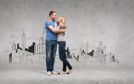 love and family concept - smiling couple hugging and looking at each other with city drawing on the back photo