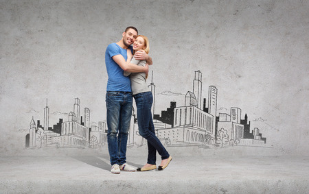 love and family concept - smiling couple hugging with city drawing on the back photo