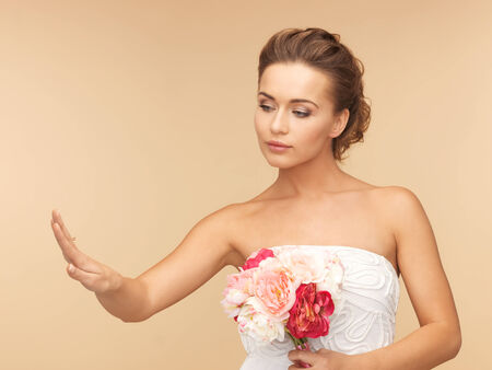 picture of bride looking at wedding or engagement ring photo