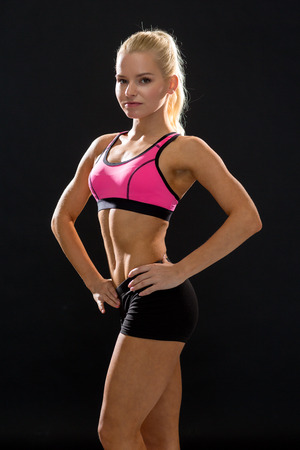 fitness, sport and diet concept - beautiful athletic woman in sportswear photo