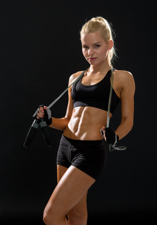 sport, exercise and healthcare - sporty woman with skipping rope photo