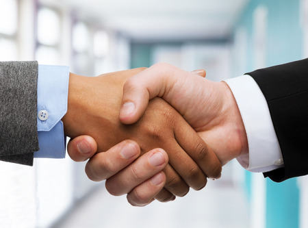 business and office concept - businessman and businesswoman shaking hands in office photo
