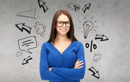 business and education concept - smiling businesswoman, teacher or student in glasses photo