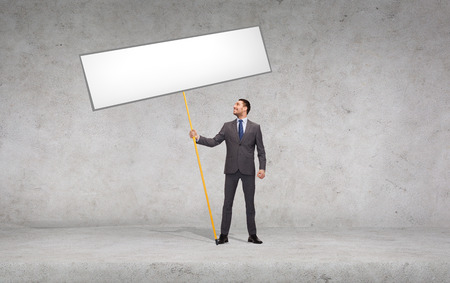 business and advertisement concept - smiling businessman holding white blank board photo