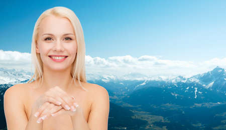 sensitive skin: health and beauty concept - face and hands of beautiful woman Stock Photo