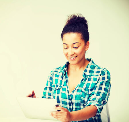 education concept - student girl with tablet pc photo
