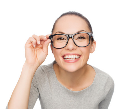 happiness, health and vision concept - smiling asian woman adjusting eyeglasses photo