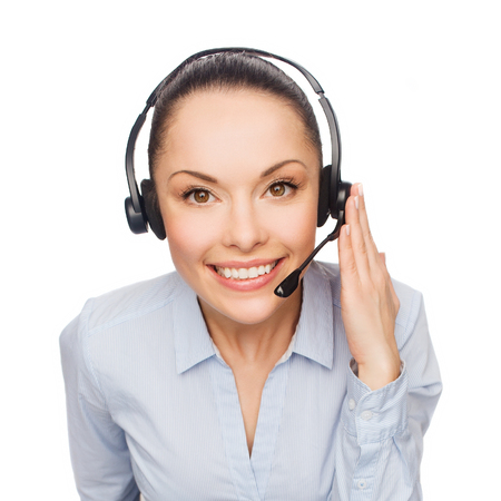 business and office concept - friendly female helpline operator with headphones photo
