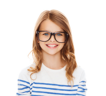 education, school and vision concept - smiling cute little girl with black eyeglasses photo