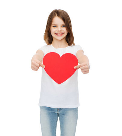 love, happiness and people concept - smiling little girl giving red heart photo