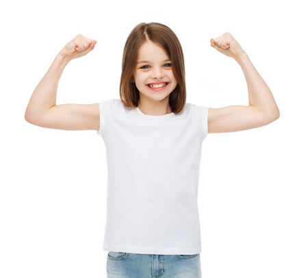 stamina: stamina, strength, health, sport, fitness concept - smiling teenage girl in blank white t-shirt showing muscles Stock Photo