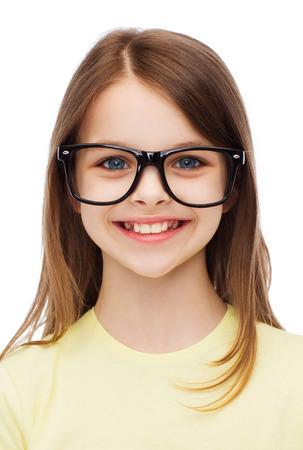 eyesight: education, school and vision concept - smiling cute little girl in black eyeglasses