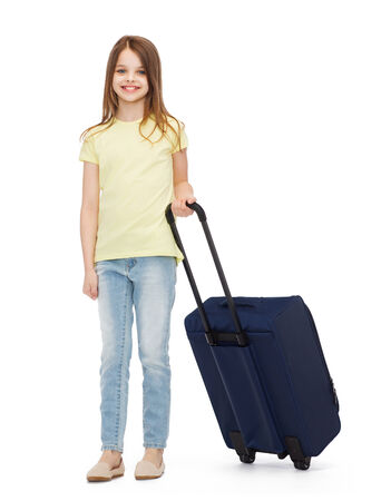 belongings: travel, holiday, vacation, childhood and transportation concept - smiling little girl with suitcase Stock Photo