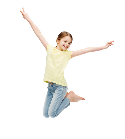 happiness, activity and child concept - smiling little girl jumping photo