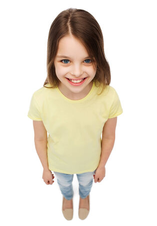 happiness and people concept - smiling little girl over white background photo