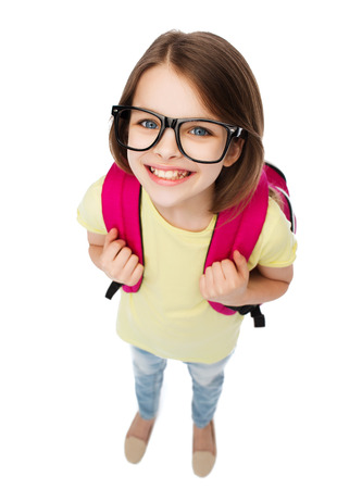 education and school concept - happy and smiling teenage girl in eyeglasses with bag photo
