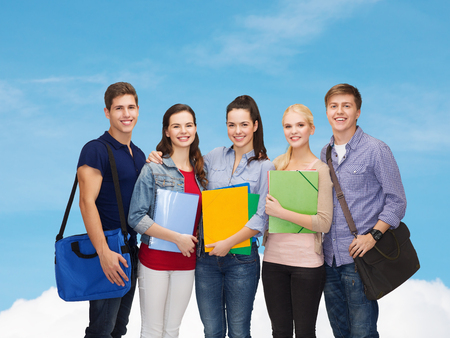 education and people concept - group of smiling students standing photo