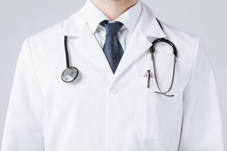 bright close up of male doctor with stethoscope photo