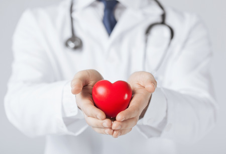 close up of man hands with heart photo