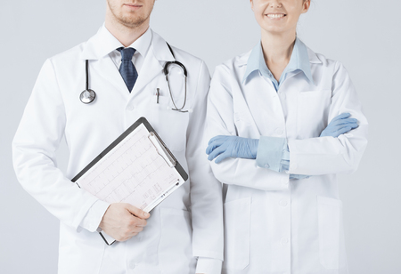 picture of nurse and male doctor holding cardiogram photo