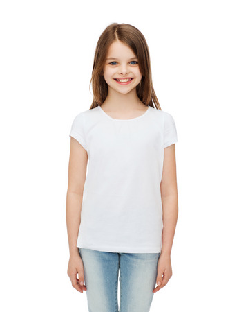 advertising and t-shirt design concept - smiling little girl in white blank t-shirt over white