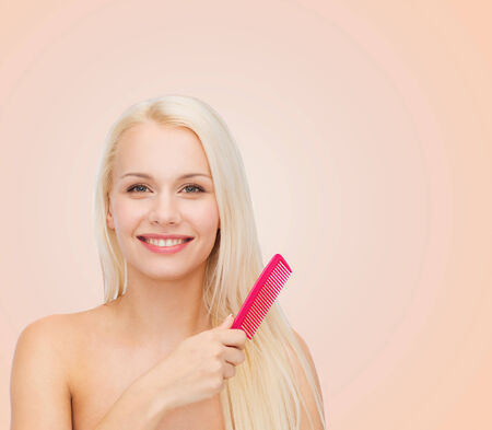 health and beauty concept - beautiful woman with long hair and brush photo