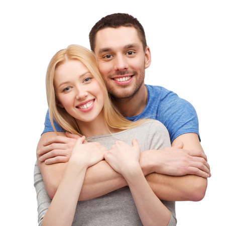 love and family concept - smiling couple hugging