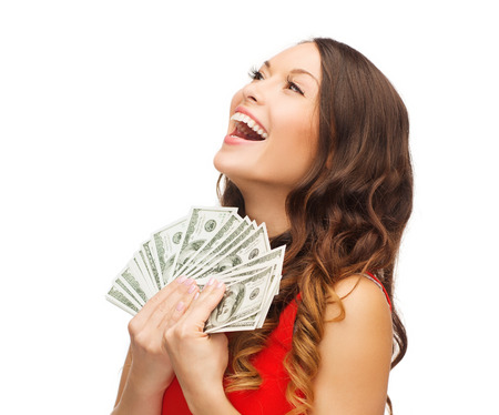 christmas profits: christmas, x-mas, sale, banking concept - smiling woman in red dress with us dollar money