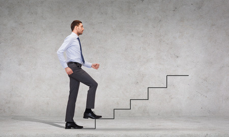 business and education concept - serious businessman stepping on step photo