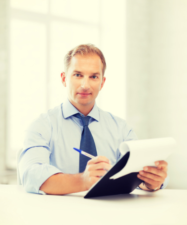 picture of handsome businessman taking employment inteview photo