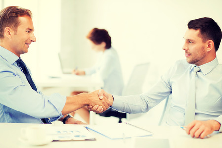 picture of businessmen shaking hands in office photo
