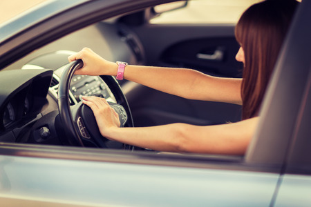transportation and vehicle concept - woman driving a car with hand on horn button Stok Fotoğraf