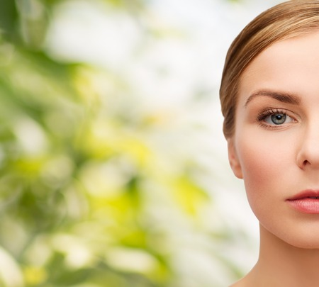 natural looking: health and beauty concept - closeup of face of beautiful young woman