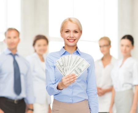 bonus: business and money concept - smiling businesswoman with dollar cash money
