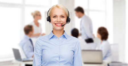 helpline: business and office concept - friendly female helpline operator with headphones