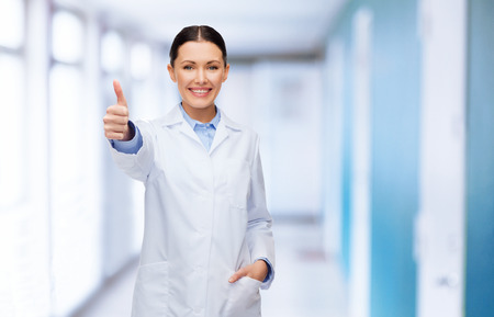 healthcare and medicine concept - smiling female doctor showing thumbs up photo