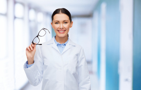 healthcare, vision and medicine concept - smiling female doctor without stethoscope Stock Photo
