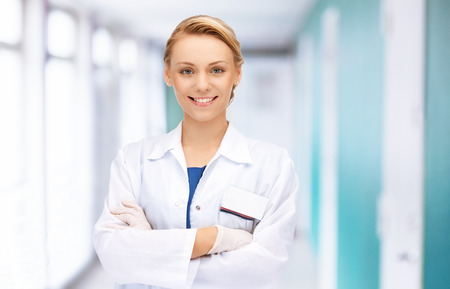 medicine and healthcare concept - attractive female doctor in hospital