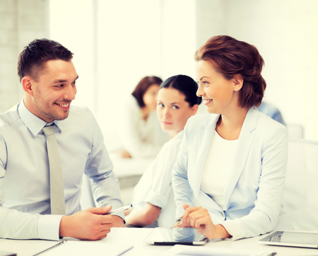 love affair: picture of business colleagues talking in office Stock Photo