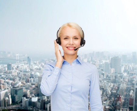 representatives: business, technology and call center concept - friendly female helpline operator with headphones