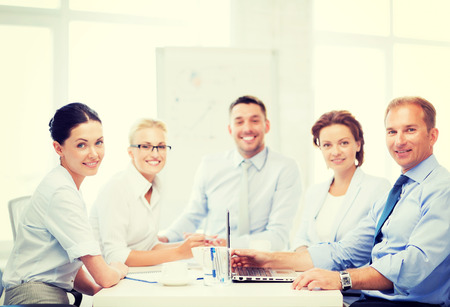 friendly business team having meeting in office photo