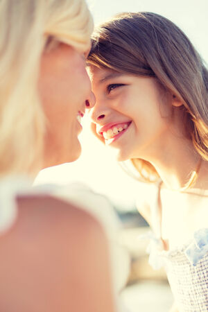 summer holidays, family, children and people concept - happy mother and child girl outdoors photo