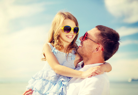 summer holidays, family, children and people concept - happy father and child girl having fun outdoors photo