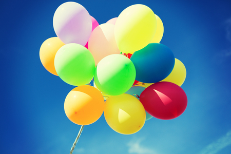balloons and celebration concept - lots of colorful balloons in the sky photo