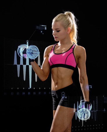 fitness, exercising and dieting concept - sporty woman with heavy steel dumbbells photo